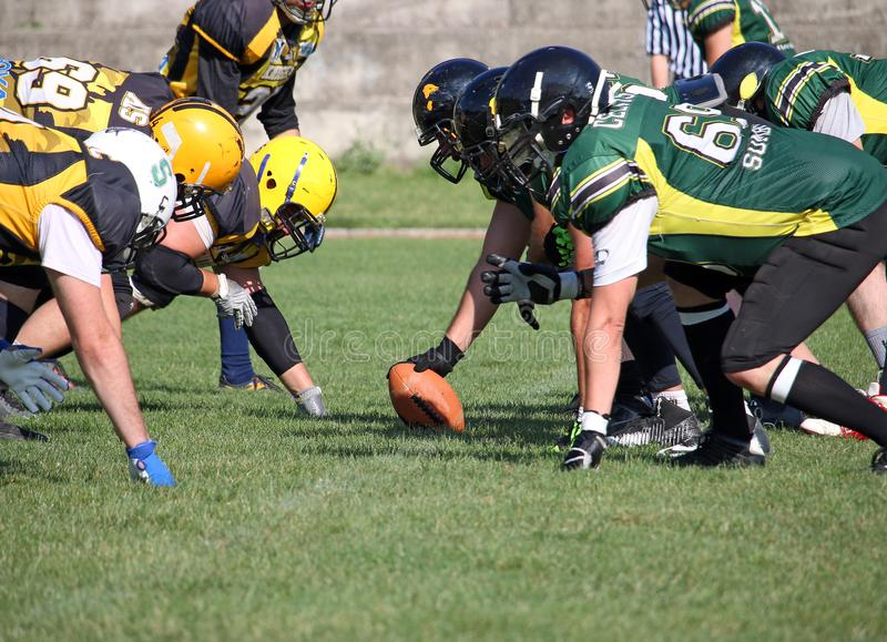 American football players on the scrimmage line royalty free stock image