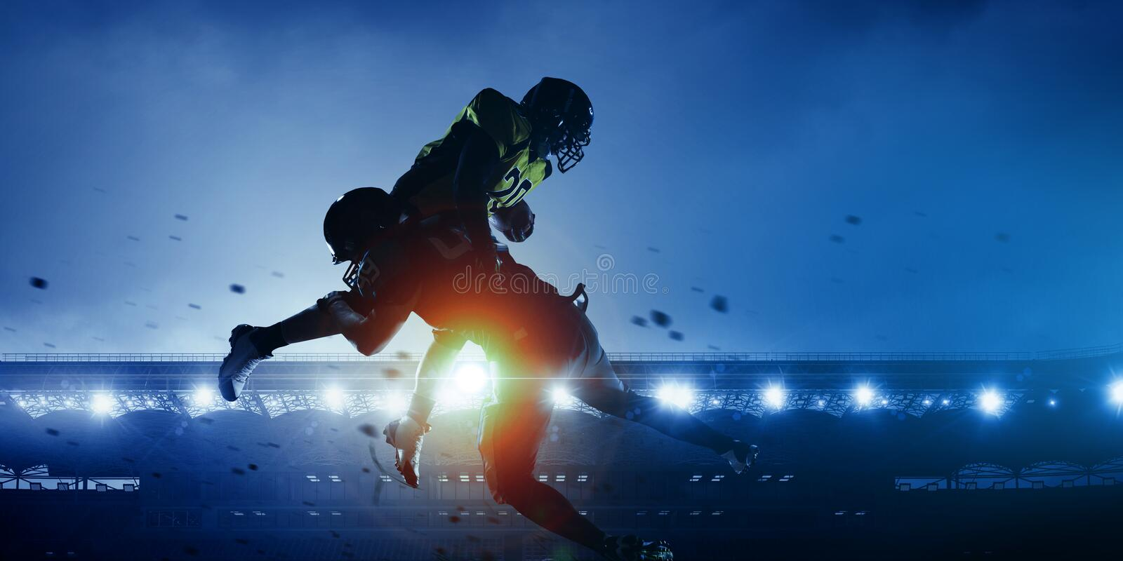 American football players on stadium in action royalty free stock photos