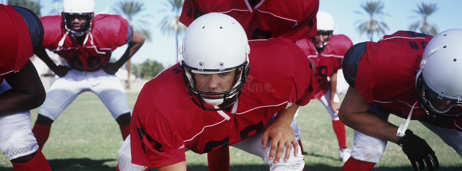 American Football Players At Start Position royalty free stock photos