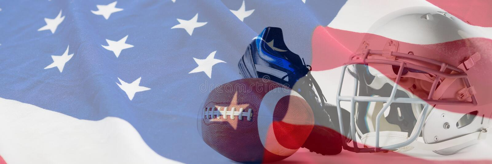 Composite image of american football with sports helmet and shoe. American football with sports helmet and shoe against american flag with stars and stripes stock photo
