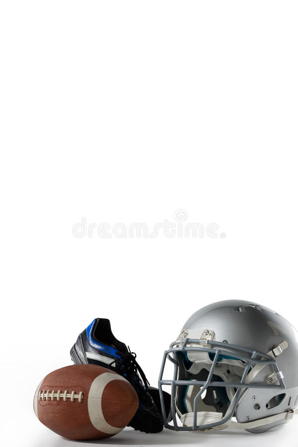 American football with sports helmet and shoe. On white background stock image
