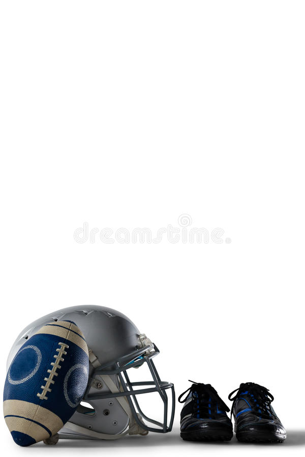 American football with sports shoes and helmet. Against white background stock photos