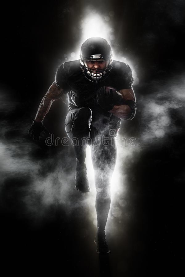 American football sportsman player running. Sport moution concept. stock photos