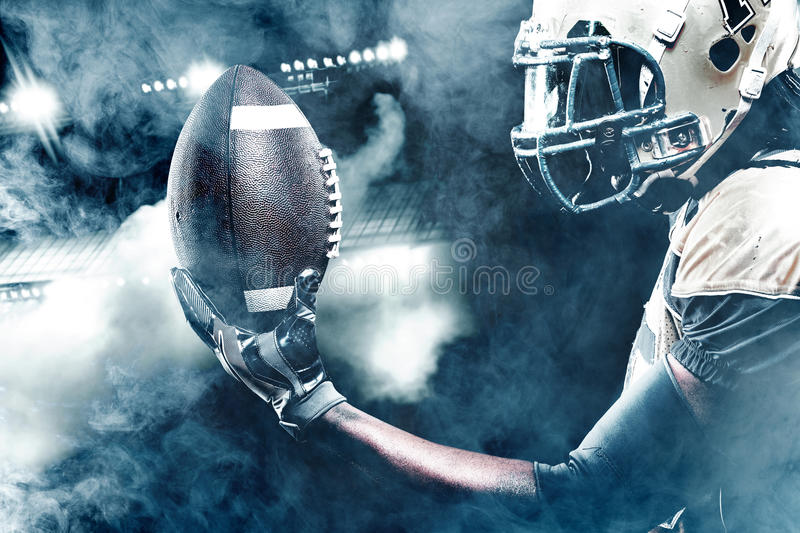 American football sportsman player on stadium running in action royalty free stock photography