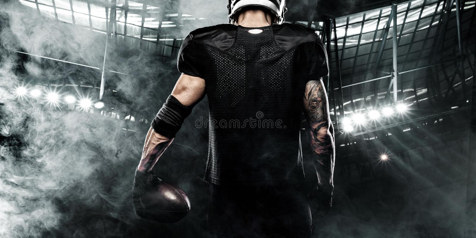 American football sportsman player on stadium. Sports banner and wallpaper with copyspace. stock image