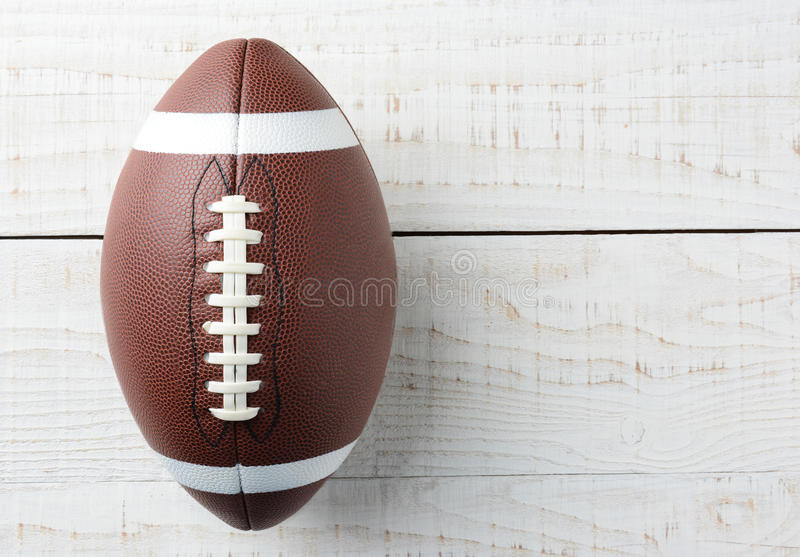 American Football on White Wood Table royalty free stock images