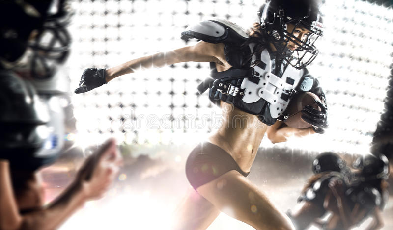 American football woman player in action stock images