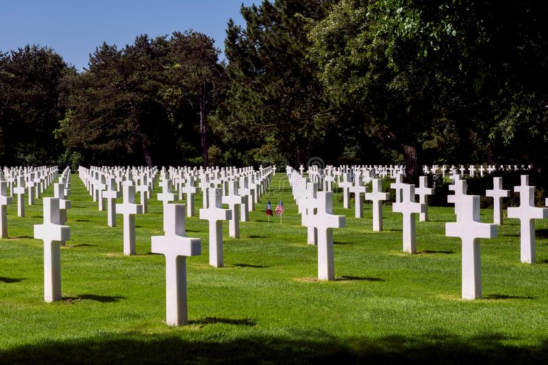 American cemetery Colleville sur Mer in Normandy. American and French flags in the middle of the graves of American soldiers who fell during the Battle of France stock image