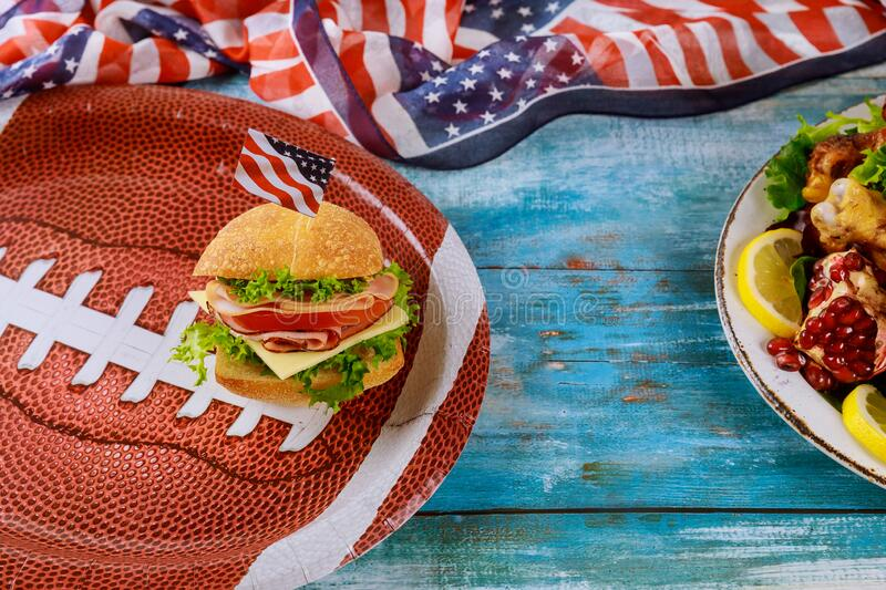 American game football food on blue wooden background royalty free stock image