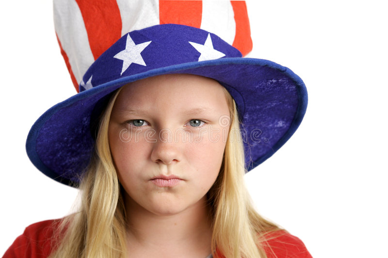 American Girl Angry. A pretty little girl in an American patriotic hat looking angry stock photography