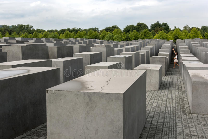 An American girl walks through the Holocaust Memorial in Berlin, Germany. stock images