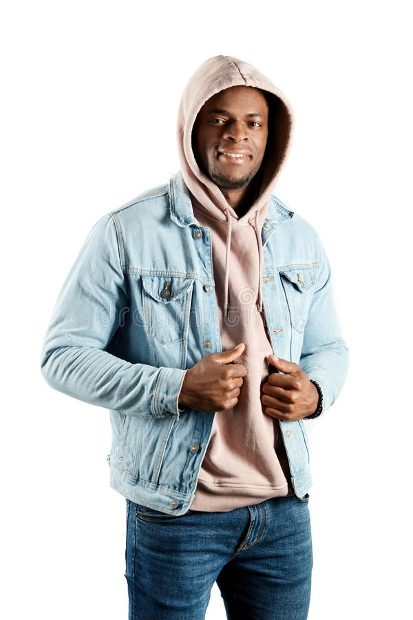 Cheerful guy dressed in pink hooded sweatshirt isolated white studio background. royalty free stock image