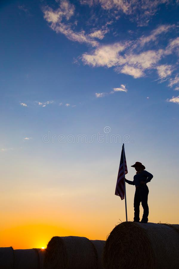 American 4H Farm girl with Flag at Sunset royalty free stock photography