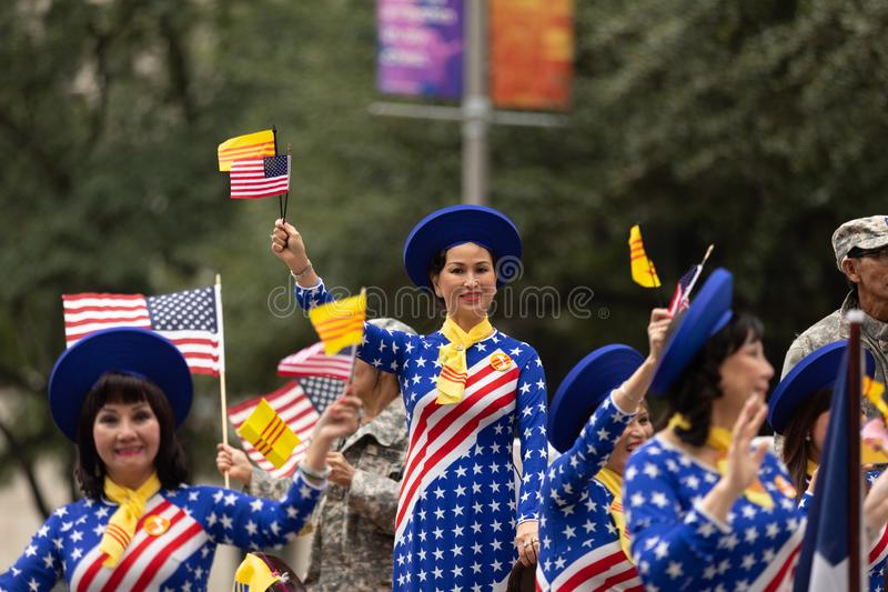 The American Heroes Parade. Houston, Texas, USA - November 11, 2018: The American Heroes Parade, Vietname women wearing traditional clothing with the colors of stock photos