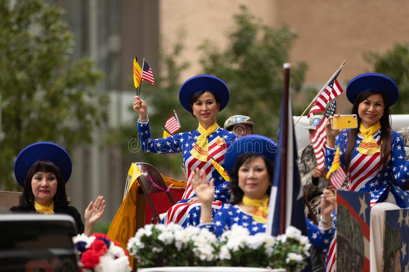 The American Heroes Parade. Houston, Texas, USA - November 11, 2018: The American Heroes Parade, Vietname women wearing traditional clothing with the colors of royalty free stock photo