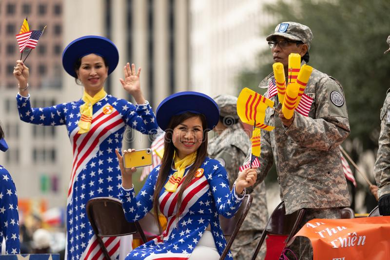 The American Heroes Parade. Houston, Texas, USA - November 11, 2018: The American Heroes Parade, Vietname women wearing traditional clothing with the colors of stock image
