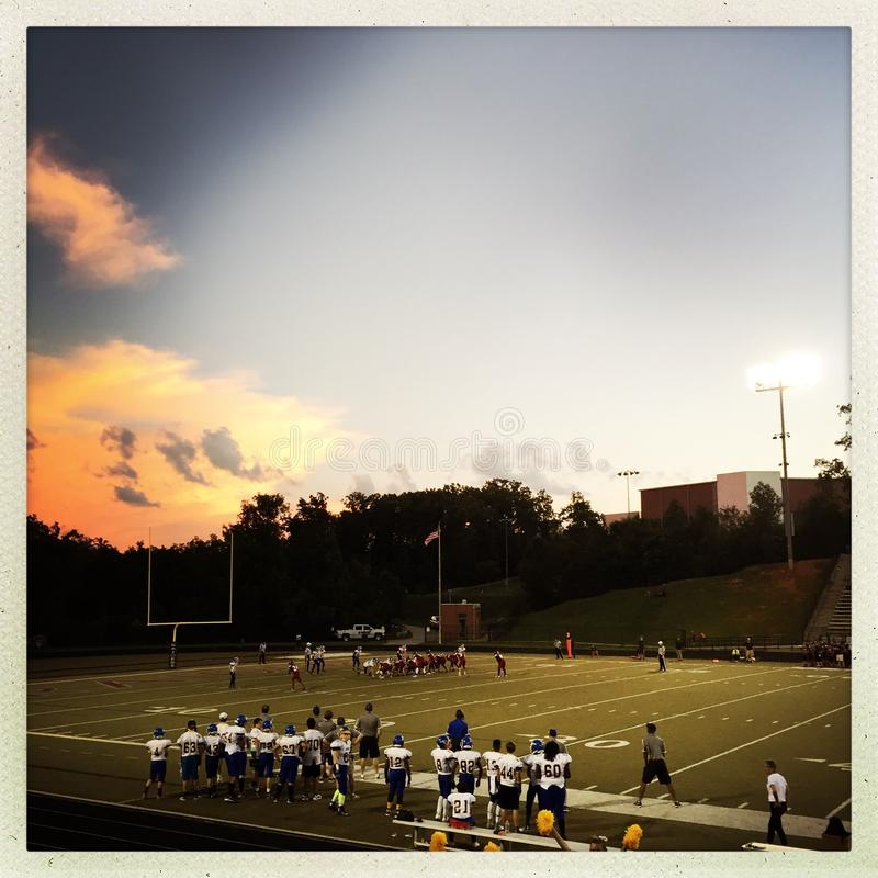 American high school football game. At sunset royalty free stock photography