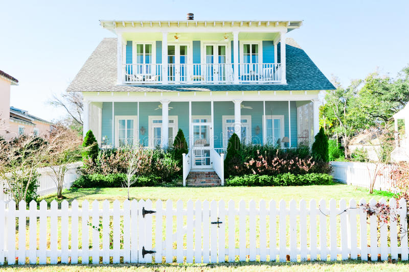 American Home. Large two-story Southern style American home with white trim and large porches royalty free stock photos