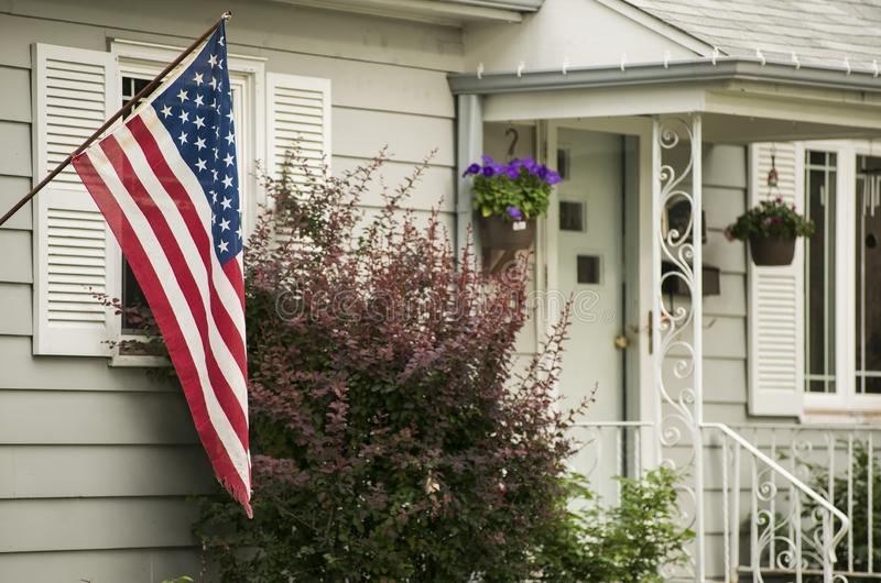 An American Home. Proudly displaying their flag stock images