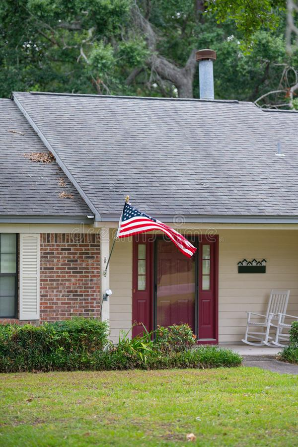 American home with flag and red door royalty free stock photo