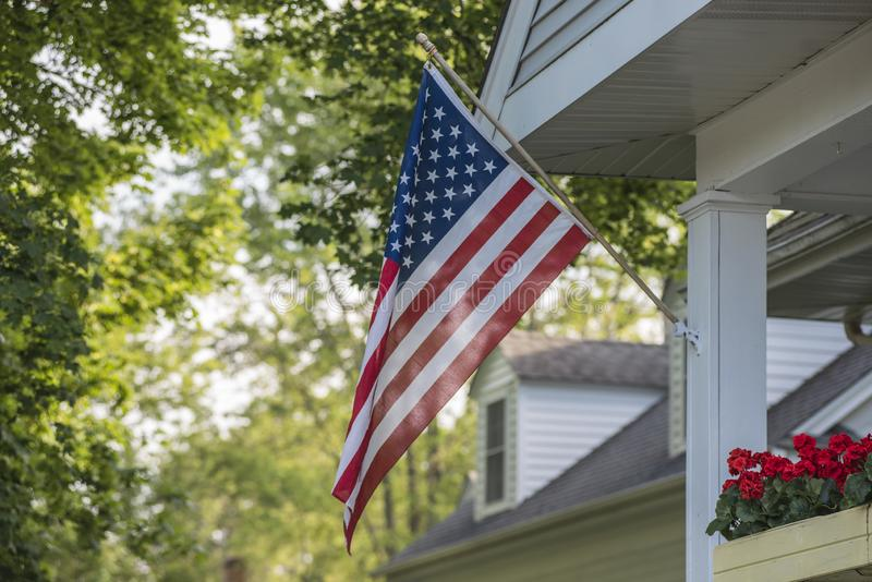 An American Home. Proudly displaying their flag stock image