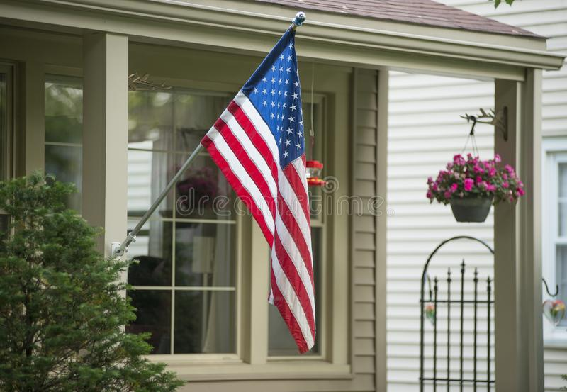 An American Home. Proudly displaying their flag stock photography