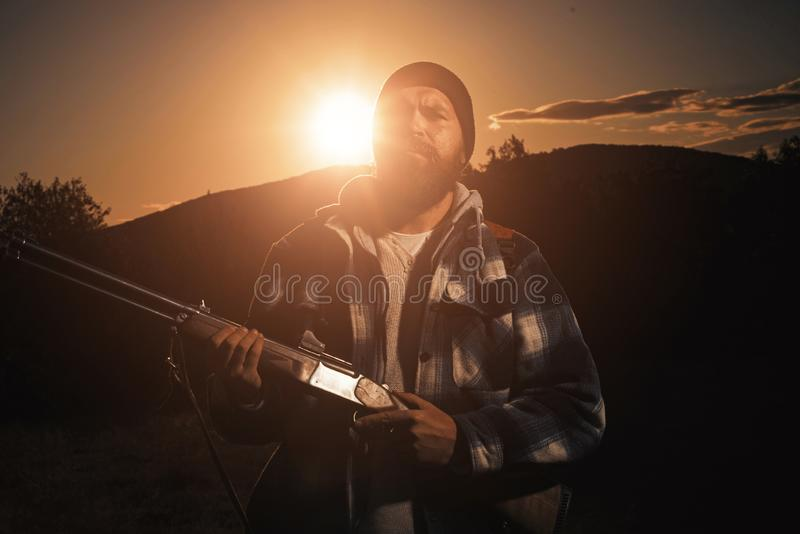 American hunting rifles. Hunting without borders. Rifle Hunter Silhouetted in Beautiful Sunset. stock images