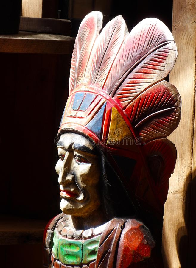 American indian chief carving in the sunlight stock photos