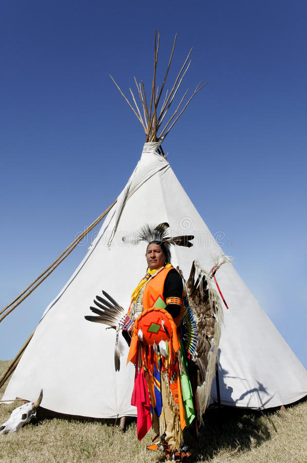 American Indian in Front of Tee Pee stock images