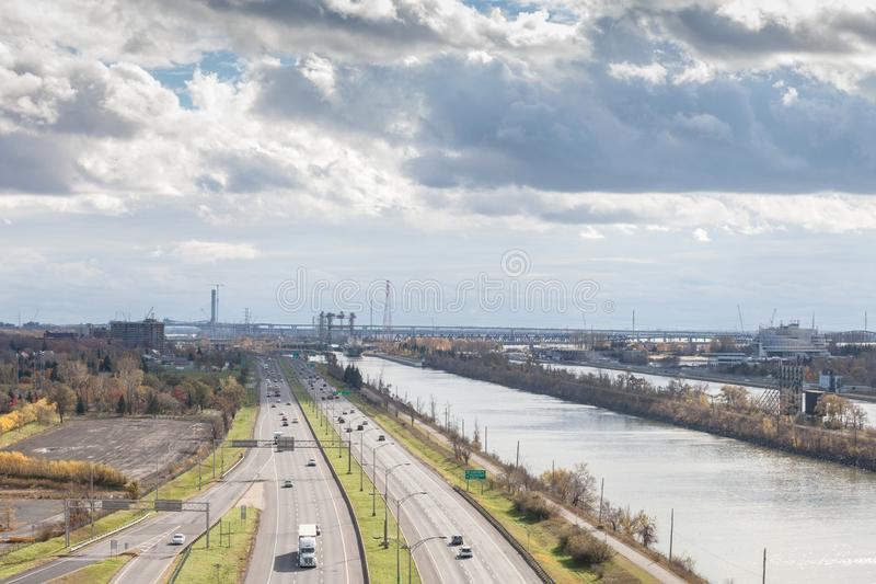 American industrial landscape in Longueuil, in South Shore Rive Sud suburb of Montreal, Quebec, with large expressway. LONGUEUIL, CANADA - NOVEMBER 8, 2018 stock images