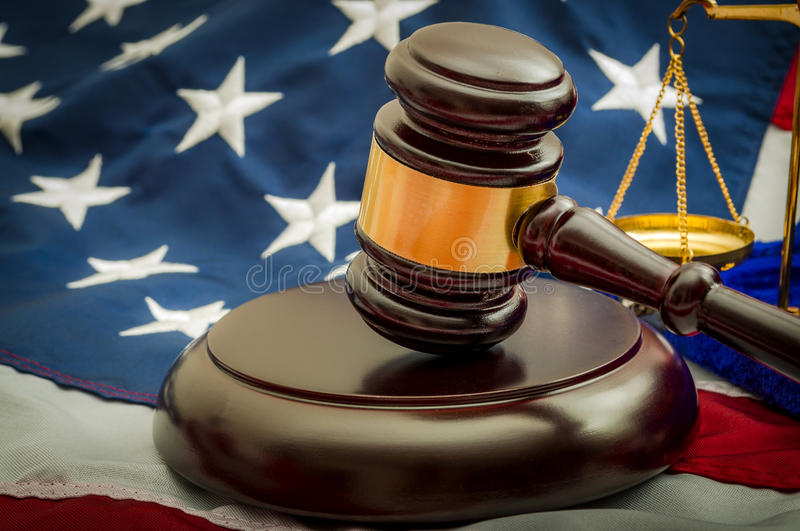 American justice system, the judicial. American flag, a golden scale and a judge's gavel symbolizing the American justice system or the Judicial Branch of stock photos