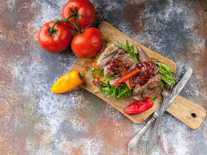 American lunch. Top view Grilled sandwich with turkey meat, fried asparagus, mushrooms, peppers, tomatoes and greens royalty free stock images