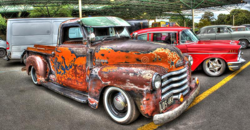 American made Chevy pickup truck. Classic American Chevy pickup truck in rusty unrestored condition on display at 2016 Greazefest a car and bike show held at the royalty free stock photography