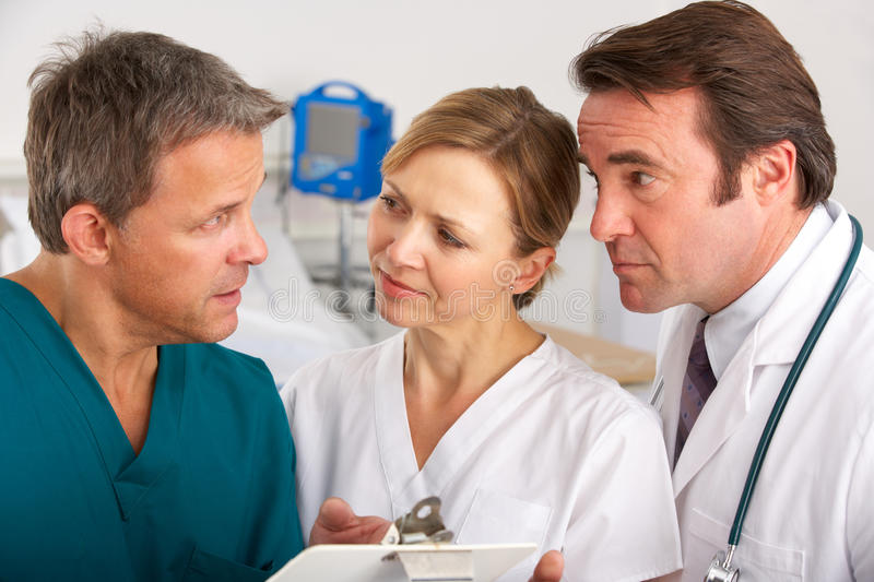 American medical team working on hospital ward. Discussing notes royalty free stock photo