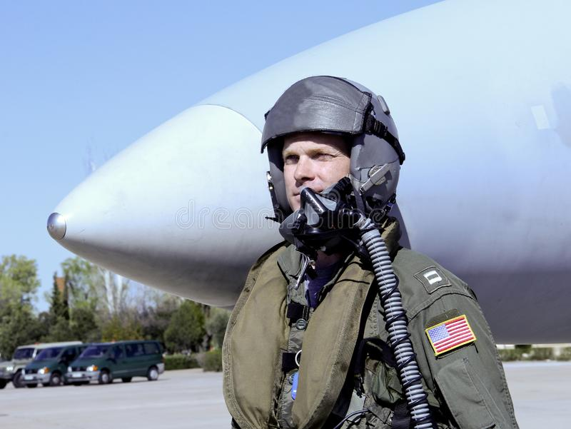 American Military Pilot in front of a Fighter Jet. Military Pilot in uniform standing in front of his fighter jet royalty free stock photo