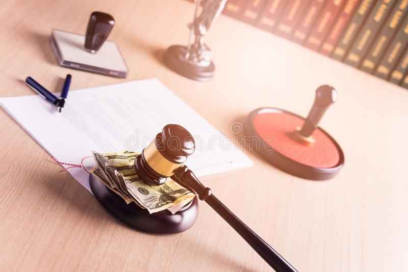 American money under the judge's gavel stock images