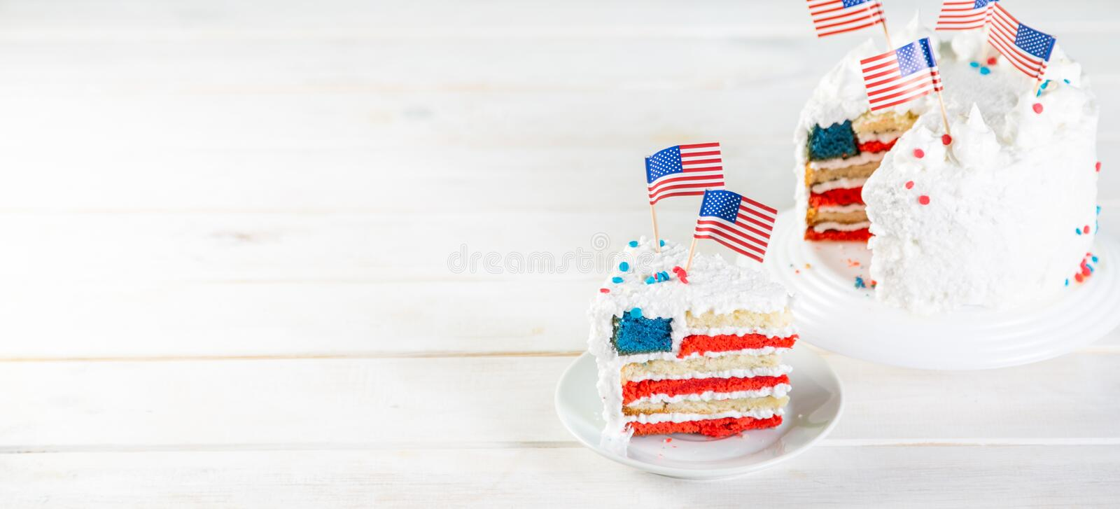 American national holidays concept - 4th of July, Memorial Day, Labour Day. Layered spounge cake in USA flag colours. Rustic background, copy space royalty free stock image