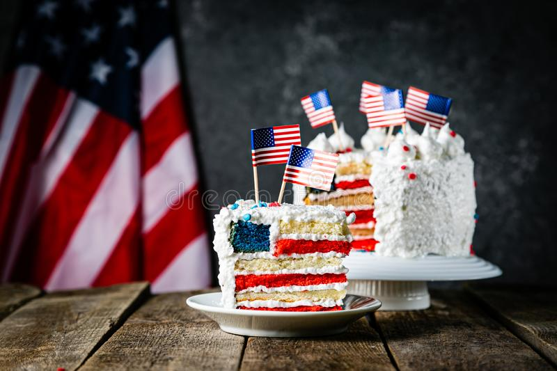 American national holidays concept - 4th of July, Memorial Day, Labour Day. Layered spounge cake in USA flag colours. Rustic background, copy space stock images