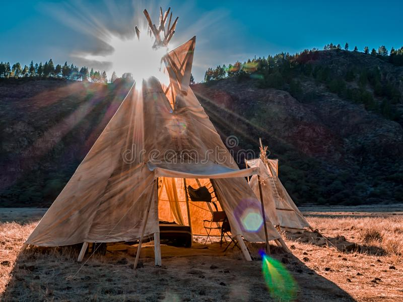 American native tent camp teepees. Teepees tent camp, home of the ancient Native Americans royalty free stock photography
