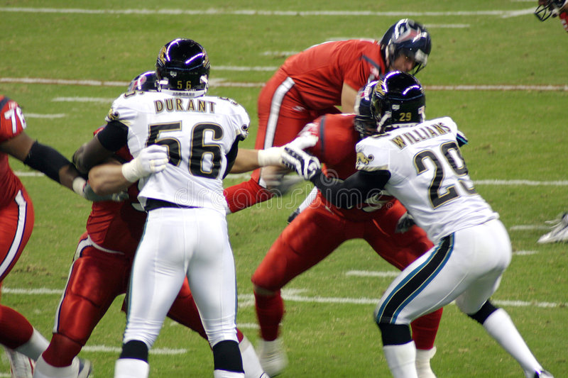 American NFL Football Players. The NFL teams, the Houston Texans and the Jacksonville Jaguars played at Houston for Monday Night Football royalty free stock photo