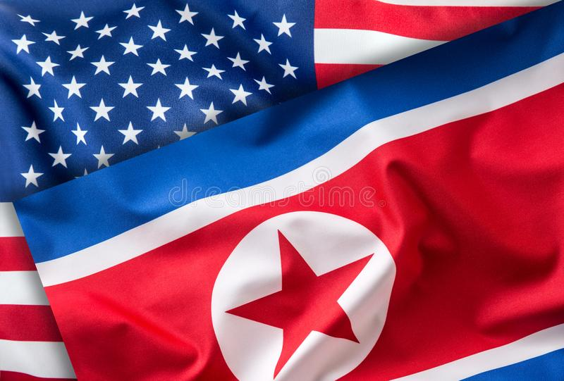 American and north korea flag. Colorful USA and North Korea flag. Waving in the wind stock photo
