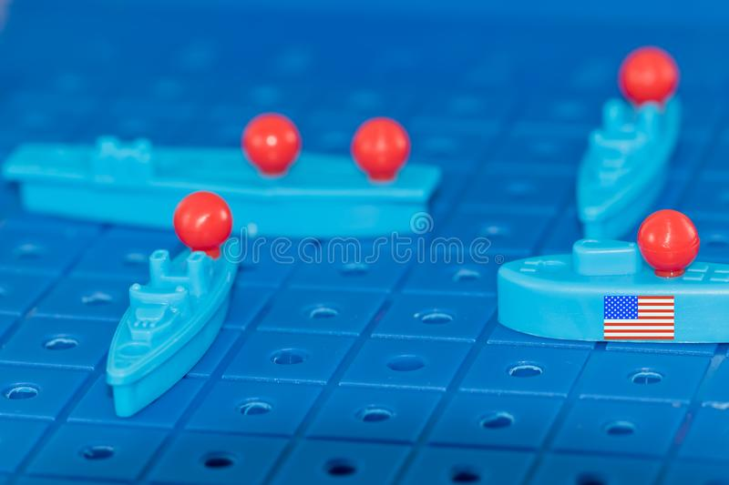 American nuclear submarine with a nuclear missile surrounded by. Enemies on the Board game battleship stock photography