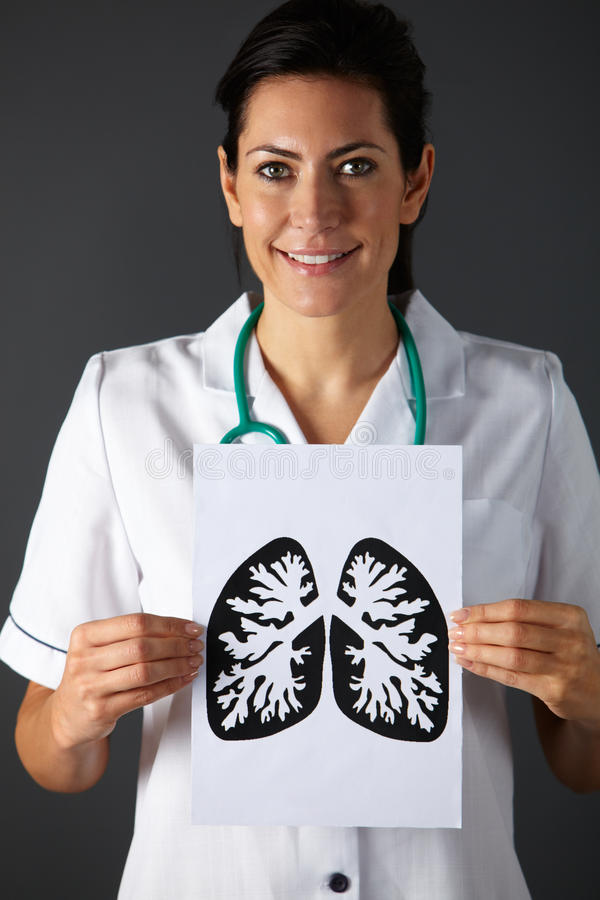 American nurse holding ink drawing of lungs. Smiling to camera royalty free stock image