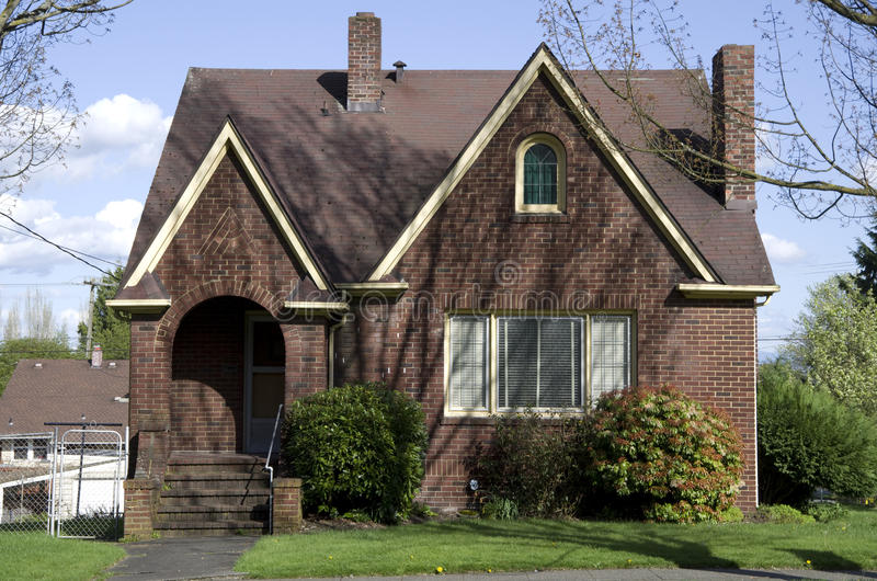 American old brick house. An small brick house at an old neighborhood in Seattle stock photo