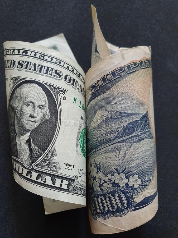 American one dollar bill and Japanese banknote of 1000 yen stock images