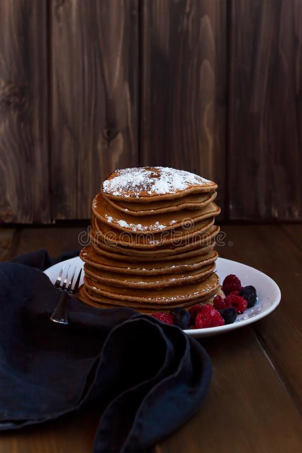 American pancakes with berries, sprinkled with sugar stock images