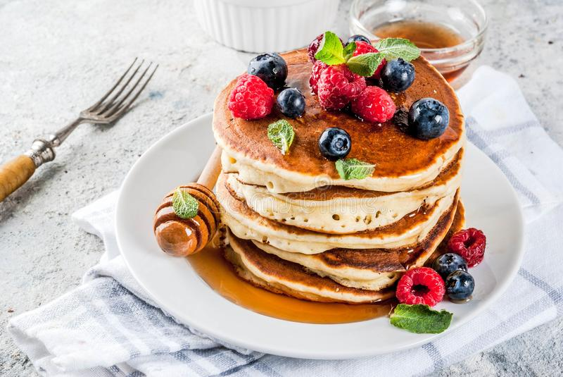 American pancakes with fresh berries royalty free stock photos