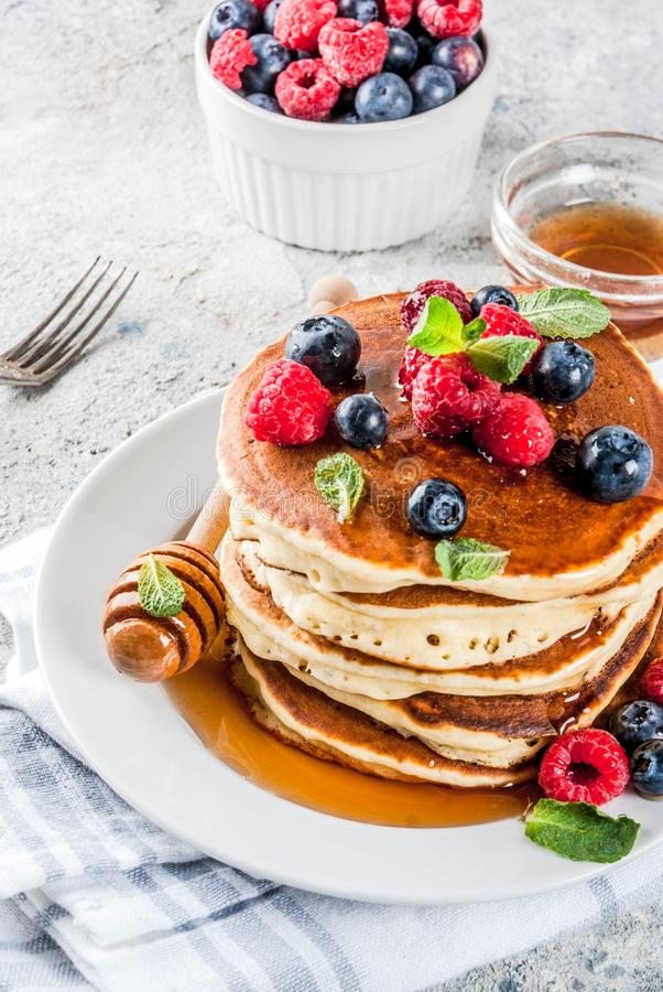 American pancakes with fresh berries stock photo