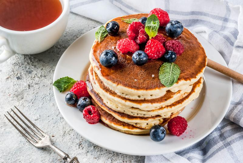 American pancakes with fresh berries stock images