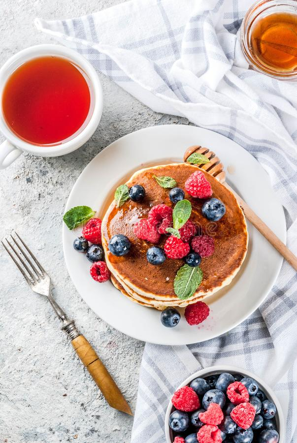 American pancakes with fresh berries royalty free stock photography